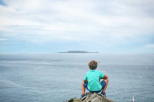 howth head ireland boy looking at irish sea on the happy list