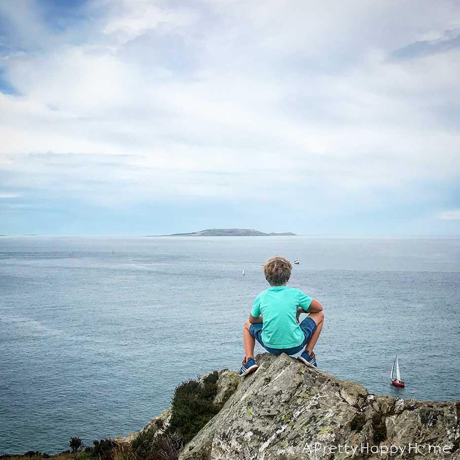 howth head ireland boy looking at irish sea on the happy list