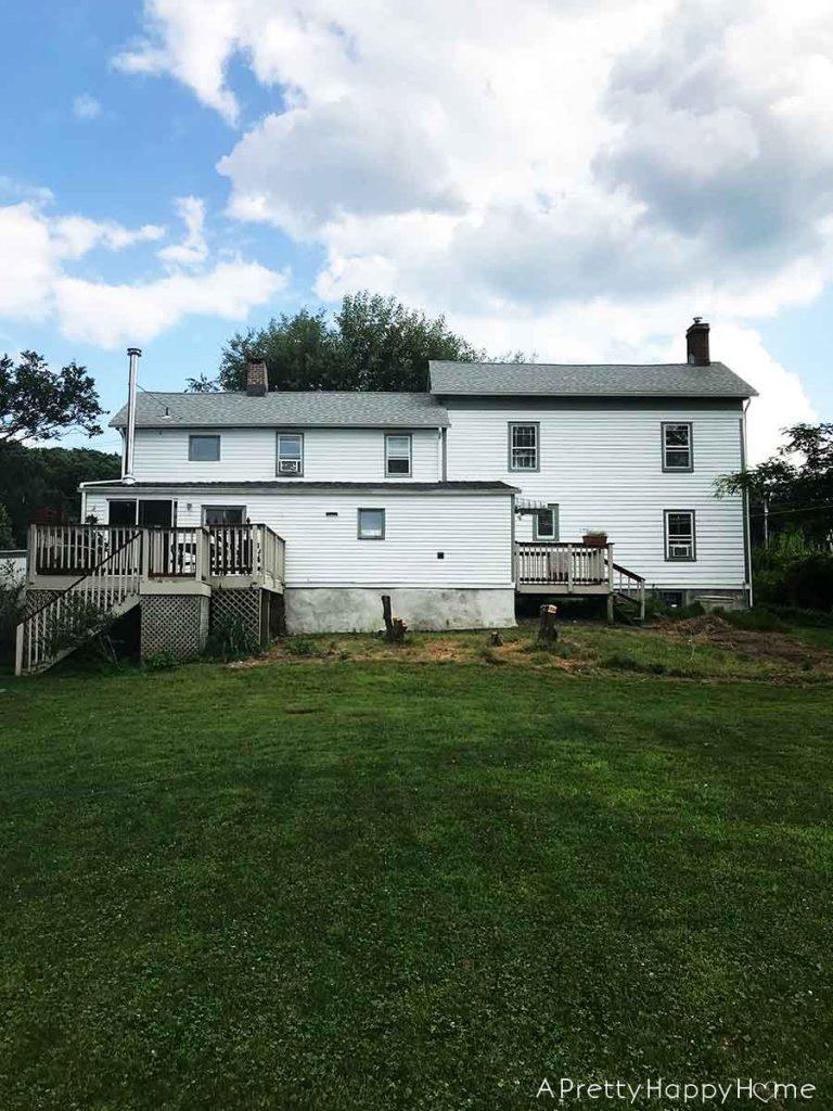 colonial farmhouse exterior 6 month progress report