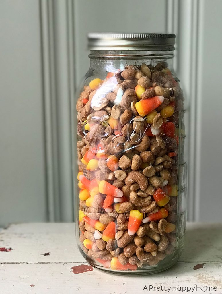 candy corn in a ball glass jar on the happy list