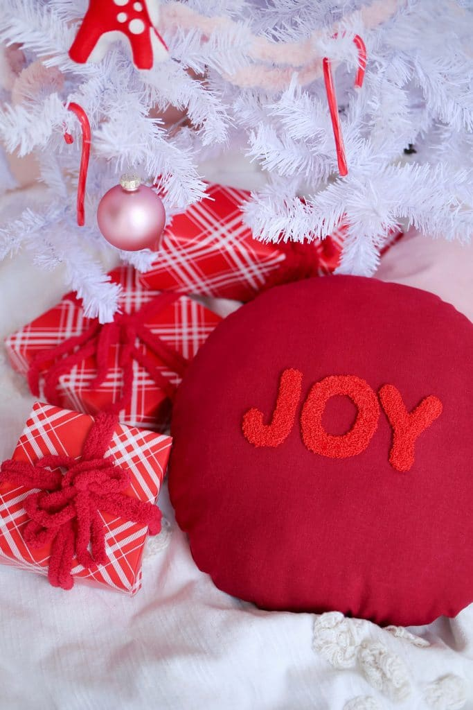 punch needle joy pillow by a beautiful mess on the happy list