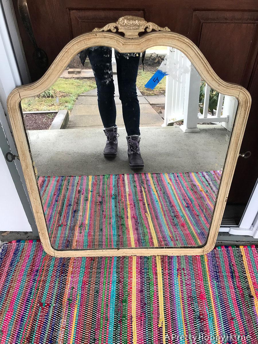 thrift store find arched wooden mirror