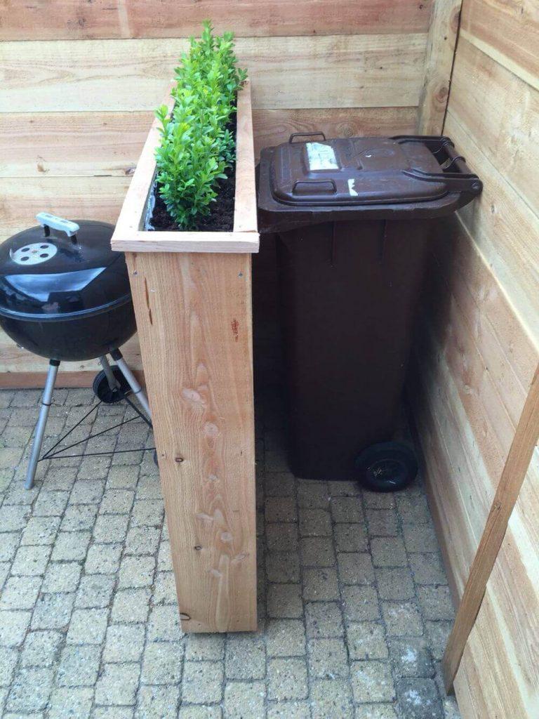 hidden garbage can planter via homebnc on the happy list