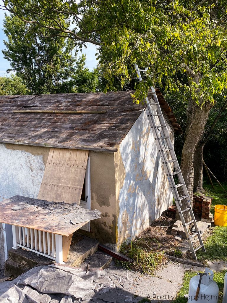 black metal roof carriage house before slate removal